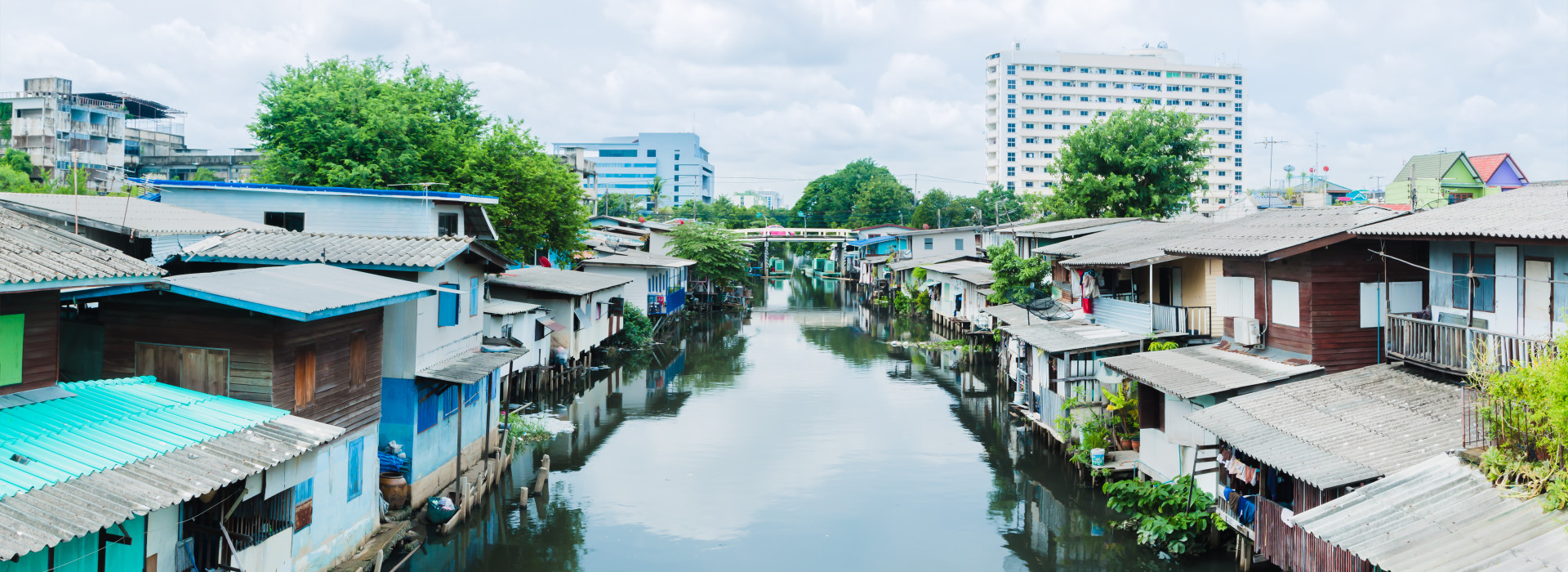 Poor house And the dirty water canal in suburb Thailand. panorama